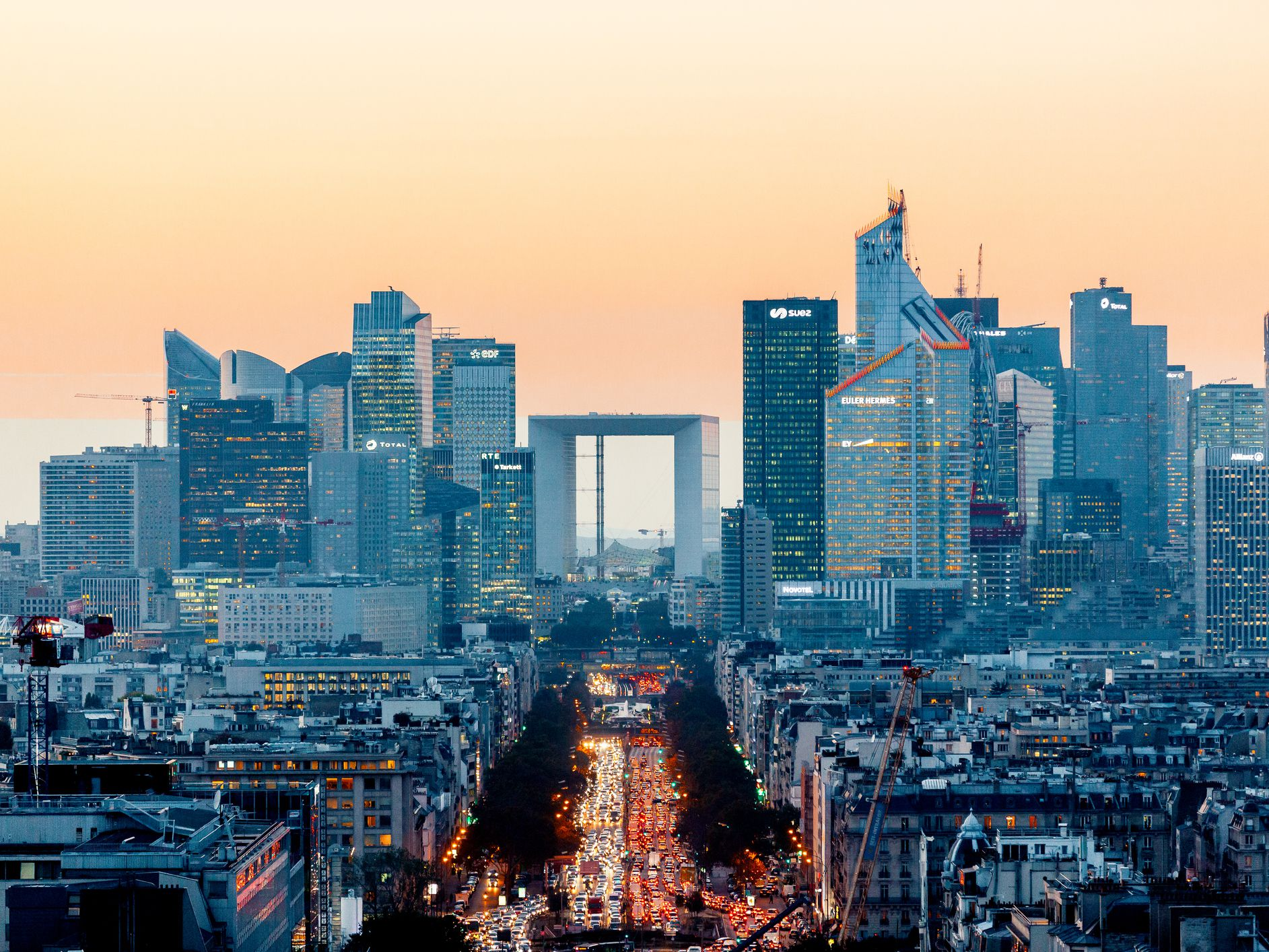 elevated-view-of-illuminated-skyscrapers-at-la-defense-financial-district-and-avenue-des-champs-elysees-at-dusk--paris--france-1095523752-3cb2b3881abc422ca187f42e70f55435